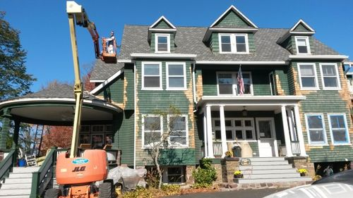Replacing cedar siding and wood rot on Victorian Mansion Bryan Athyn, PA