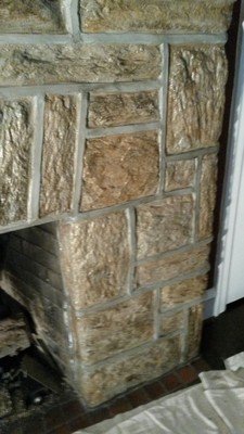 Fireplace had been painted pure white. Instead of stripping it down to bare stone, we painted it to look like the original stone using colors from the stone and mortar in the adjacent sun room Jenkintown, PA